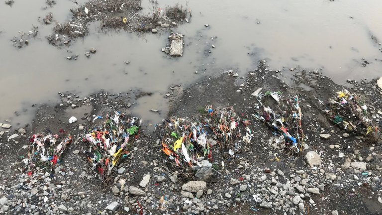 PLASTIC POLLUTION AT RIVER BANK